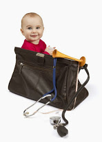 bigstock-Toddler-In-Midwifes-Case-28213640